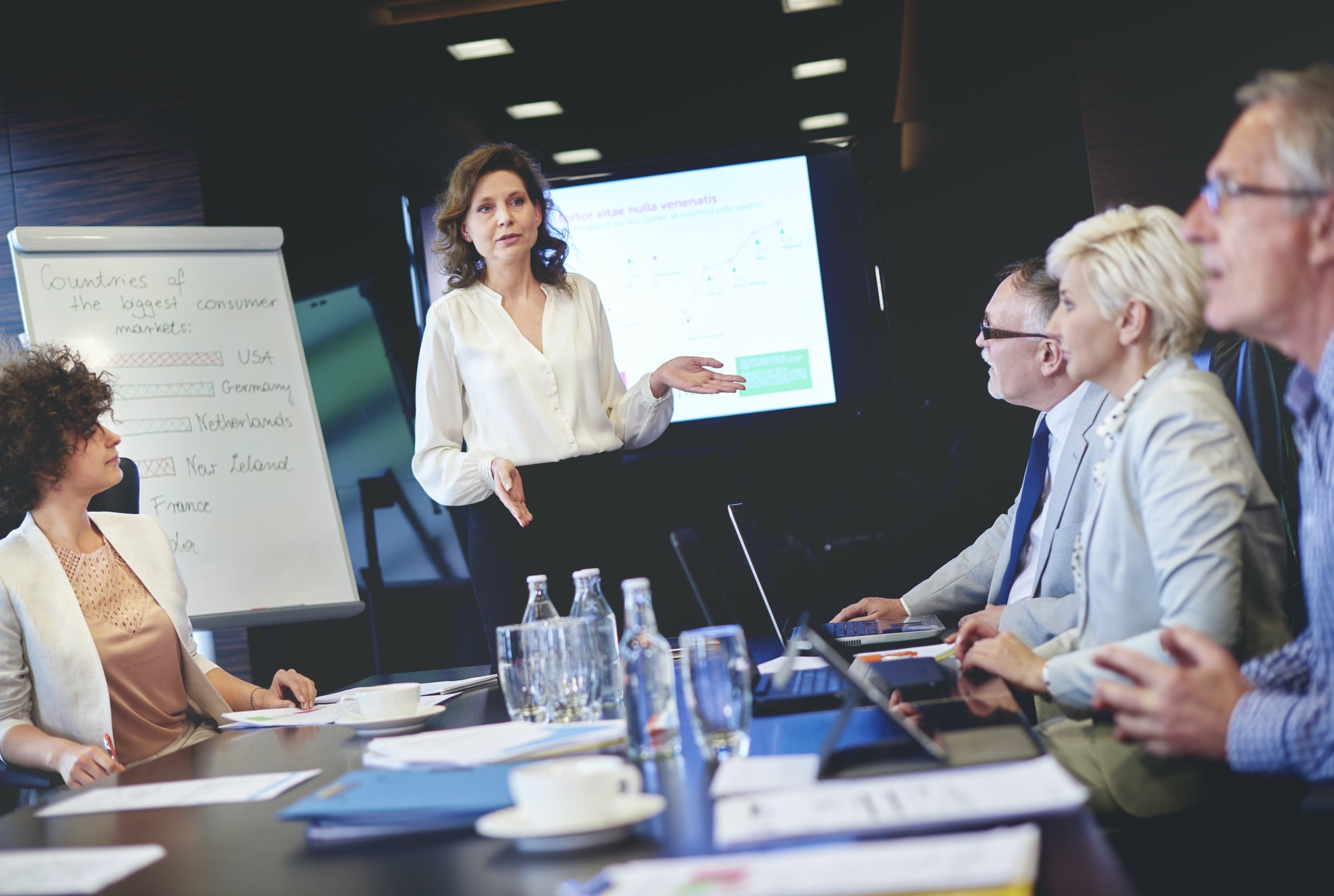 Female public speaker over conference